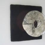 felt, mirror, copper spiral, paper, feathers 45 x 55 x 27 cm / 2002